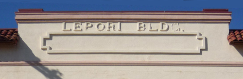 Stucco letters before restoration