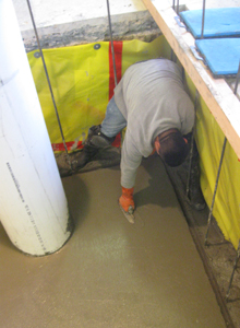 Finishing touches are added to the newly poured concrete floor.