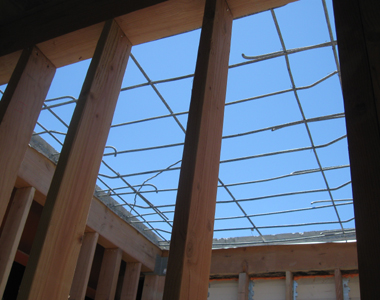 Sky is seen through the rebar where the concrete roof has been removed.