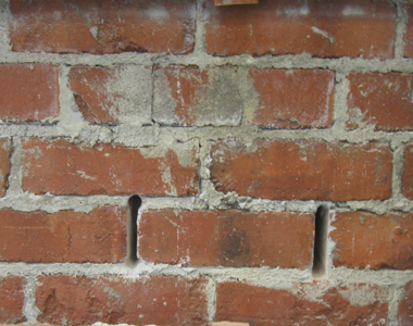Mortar joints removed at each end of a brick before testing.