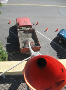 Funnel and pipe for removal of gravel from the roof.
