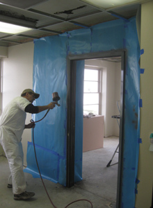 A door frame is painted as a part of the re-finishing process.