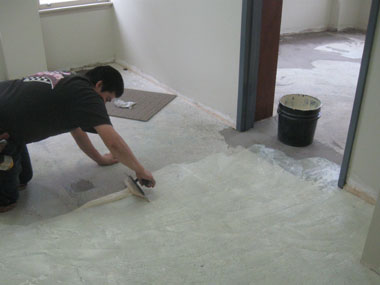 Carpet adhesive is spread in one of the upstairs suites.