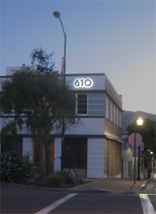 LED lit Streamline Moderne address numbers at dusk.