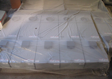 Electric panels under a plastic painter's tarp.
