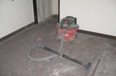 A shop vacuum used to remove three years of construction dust on the carpet.