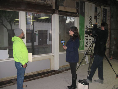 ABC Channel 7 News reporter Elissa Harrington interviews Southport Land employee.