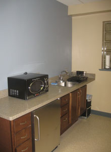 Appliances and other furnishings finish the break room in the upstairs common area.