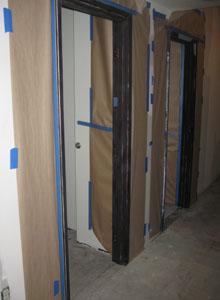 Masking for painting door frames.