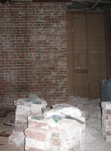 Interior brick wall after partial demolition to remove an unsafe portion.