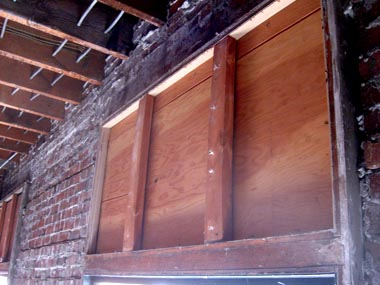 Plywood discovered where a transom window once was.