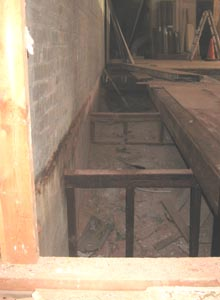 Demolition revealed a ramp that once led to the basement.
