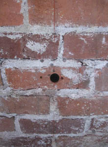 Hole drilled into bricks at 22-1/2 degree angle.