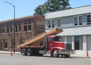 A special order load of lumber arrives from Berry's Sawmill, Inc.