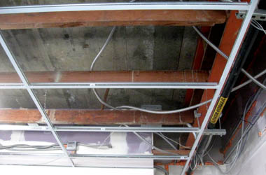 Suspended (T-Bar) ceiling grid.