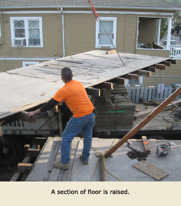 House Moving by Trost: A section of floor is lifted.
